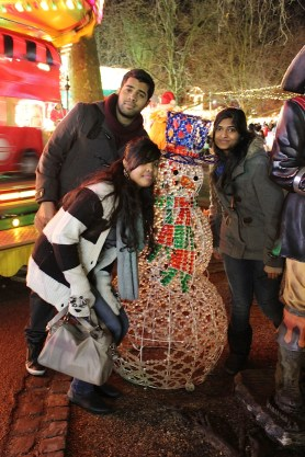 Posing with Snowman