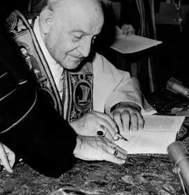 "Pope John XXIII signs his encyclical ""Peace on Earth"" (""Pacem in Terris"") at the Vatican in this 1963 file photo. Considered a highlight in Catholic social teaching, the encyclical addresses universal rights and relations between states. The document marks its 50th anniversary April 11, the date of its issue. (CNS photo) (April 1, 2013)"