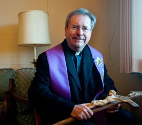 It does not matter whom the bishop appoints as the diocese's mandated exorcist.
