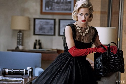 Because every wheelchair detective needs an elegant accomplice. Gucci's point d'esprit tulle dress gets a makeover with scarlet elbow-length gloves and a devilish lip. Dress, $4,200; select Gucci boutiques. Three-strand pearl necklace from House of Lavande. Carolina Amato gloves. Prada handbag.