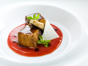 Lamb cube on tomato sauce, salty ricotta and basil