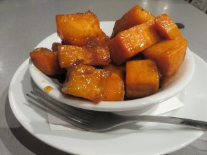 A side dish of root beer sweet potatoes.