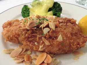 Fried black drum with toasted almonds and broccoli with a creamy sauce