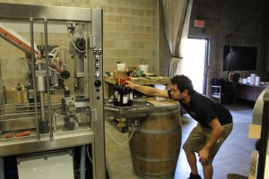Chris overseas the bottling process for Quantum Leap Winery/