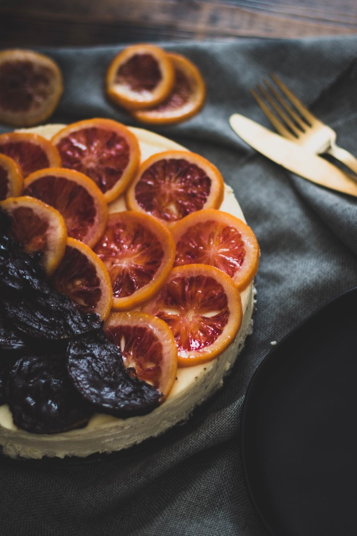 Cheesecake Topped with Candied Blood Oranges and Dark Chocolate
