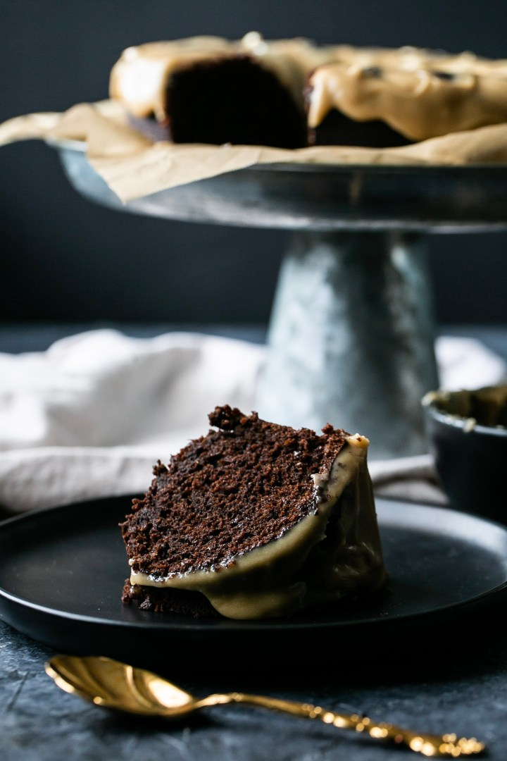 A slice of chocolate cake with salted caramel on top