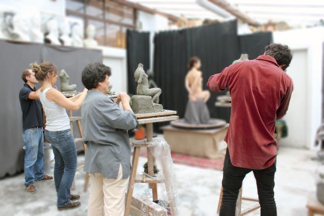 People in a sculpting a sculpting class
