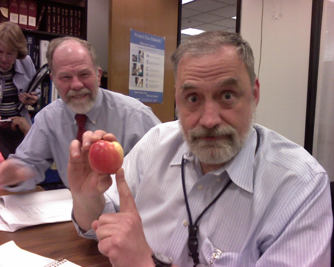 Administrators talking about apples