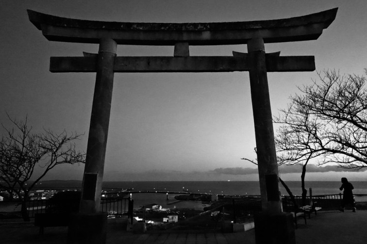 Photo: A Shinto Torii gate sits atop a hill in Ishinomaki, where more than 3,000 people drowned in the 2011 tsunami. Thousands of others remain missing. Many fled to this hilltop to survive. (Source: NPR)