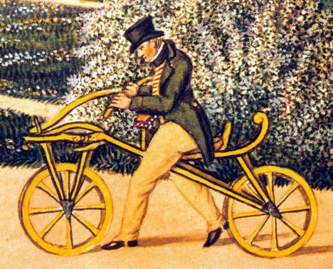 Karl von Drais on his original Laufmaschine, the earliest two-wheeler, in 1819