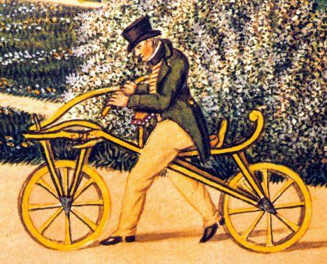 Karl von Drais on his original Laufmaschine, the earliest two-wheeler, in 1819