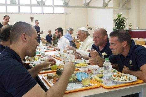 Pope Francis eats with Vatican workers during a surprise visit to the Vatican cafeteria July 25. (CNS photo/L'Osservatore Romano via Reuters) (July 25, 2014) See CAFETERIA-POPE July 25, 2014.