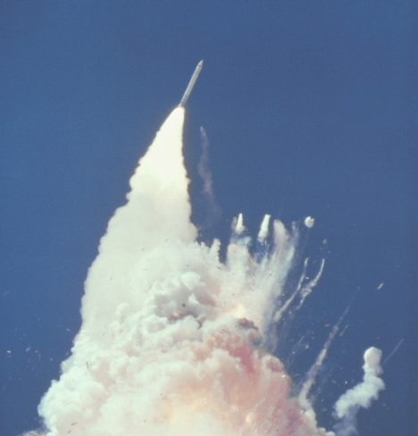 At about 76 seconds, fragments of the Orbiter can be seen tumbling against a background of fire, smoke and vaporized propellants from the External Tank. The left Solid Rocket Booster (SRB) flys rampant, still thrusting. The reddish-brown cloud envelops the disintergrating Orbiter. The color is indicative of the nitrogen tetroxide oxidizer propellant in the Orbiter Reaction Control System. Challenger_Rocket_Booster_-_GPN-2000-001422