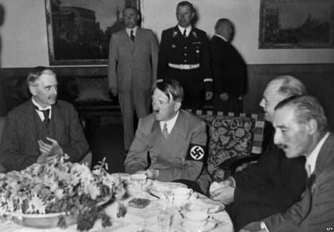 Neville Chamberlain and Adolf Hitler meet for the