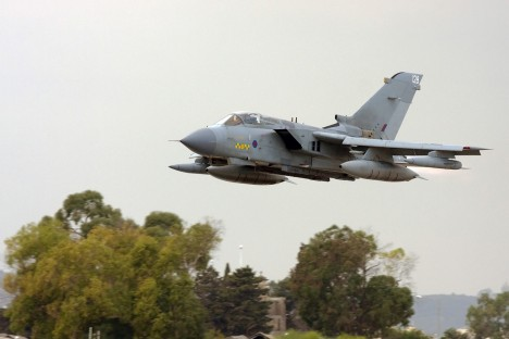RAF Tornado GR4 taking off low and fast with afterburners.