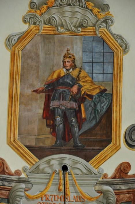 Přemysl Otakar I. na vyobrazení v Břevnovském klášteře. Český král se snaží zvýšit zisky z půdy, a proto zve do Čech německé kolonisty.