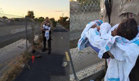 Strážník s malou holčičku, kterou právě vytáhl z improvizovaného hrobu.