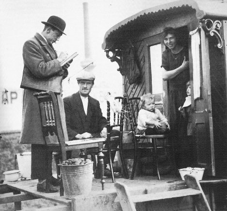 Census taker visits a Romani family living in a caravan, Netherlands 1925