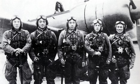 In this photo provided by former Kamikaze pilot Toshio Yoshitake, shows Yoshitake, right, and his fellow pilots, from left, Tetsuya Ueno, Koshiro Hayashi, Naoki Okagami and Takao Oi, pose together in front of a zero fighter plane before taking off from the Imperial Army airstrip in Choshi, just east of Tokyo, Nov. 8, 1944. None of the 17 other pilots and flight instructors who flew with Yoshitake on that day survived. Yoshitake, now 82, is alive today and able to see the 60th anniversary of the end of World War II in August only because an American warplane shot him out of the air. He crash landed and was rescued by Japanese soldiers. (AP Photo)