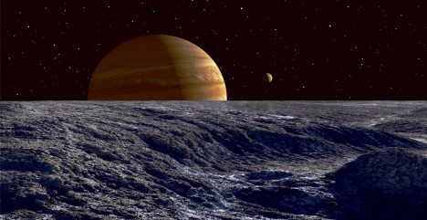 The gas giant Jupiter seen above the surface of Jupiter's moon Europa.