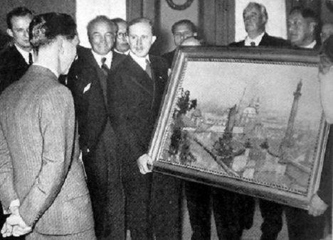 Delegace daruje Goebbelsovi obraz Prahy od malíře Jaroslava Šetelíka.