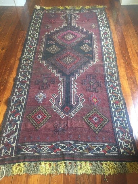 afghani tribal rug handknotted purple background