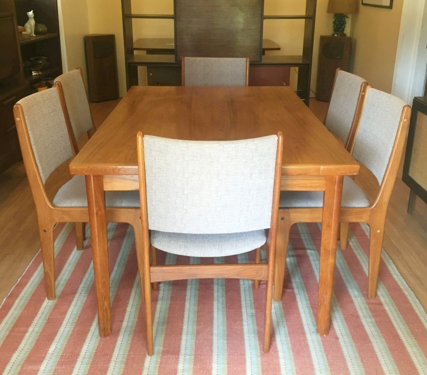 e1c5d83b794e This utilitarian Danish Modern Teak Refectory Table has two extensible  leaves stored under the center panel