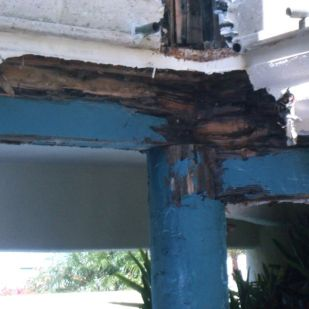 A. For years water leaked into the plaster and rotted out this area of the post and column.