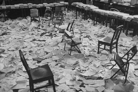 Papers covering the courts transcript room after a war crimes trial in Germany