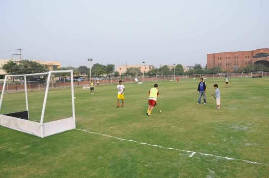 Children playing hockey in Sports Complex Sector XX DHA Lahore Phase III