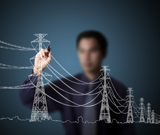A person drawing an electricity grid