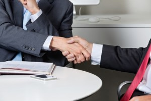 Midsection Of Businessmen Shaking Hands