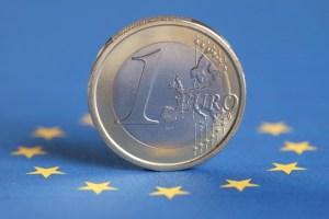 Euro coin in an EU flag