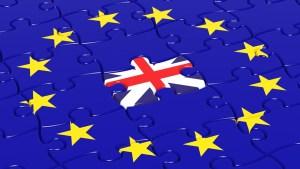 Jigsaw puzzle flag of European Union with United Kingdom flag piece.