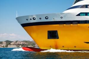 Big yellow passenger ferry ship, bow fragment