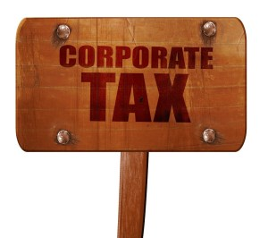 corporate tax, 3D rendering, text on wooden sign