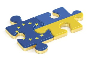 Ukraine and EU puzzles from flags, 3D rendering