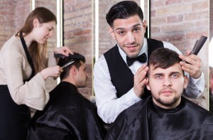 Hairdresser discussing hairstyling with male client