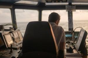 Deck navigation officer on the navigation bridge. He looks at radar screen