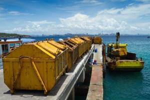 Yellow garbage bin on the dock.
