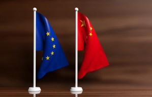 China and EU flags on wooden background. 3d illustration