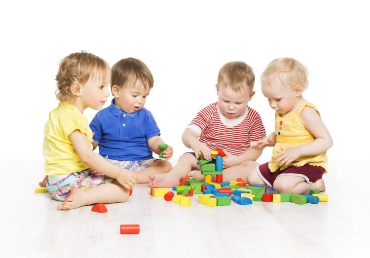 Children Group Playing Toy Blocks. Little Kids Early Development