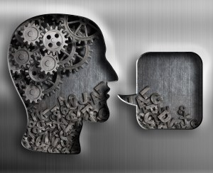 Metal gears, cogs and characters inside of human head silhouette with speech bubble