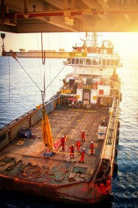Boat,Supply Boat during offload cargo from oil and gas platform to onshore