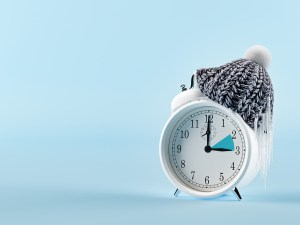 clock changing from summer to winter time. 3d rendering