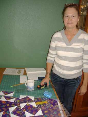Mary with completed flying geese blocks.
