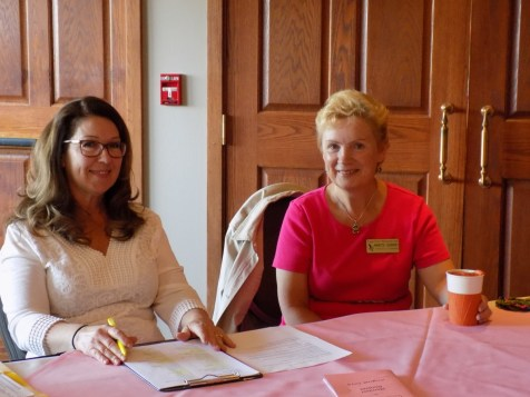 New luncheon coordinator, Ruth Hewitt, and new president, Annette Godfrey, greet guests at the door of the luncheon room.
