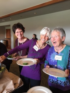 The ladies in purple share a laugh waiting in the food line.