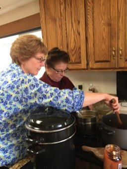 Betsy Hase and Linda Haynsworth-Krueger share the cooktop while making chutney and lemon curd