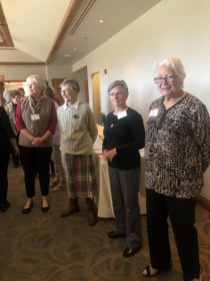 Pat Ashley, Sue King, Cecilia Daniello and Denise Boe eagerly awaiting their turn at the lunch buffet.